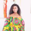 Zim Queen Sharma in Angelle Fenton in Sunflower 2-piece Ankara Print Crop Top and thigh-High Split Maxi Skirt by Yvonne Irenroa African Fashion