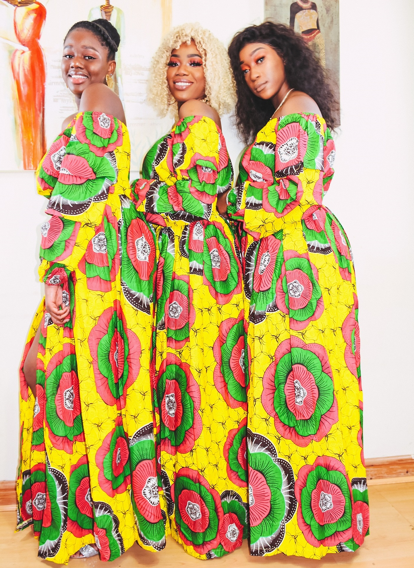Black Queens in Angelle Fenton in Sunflower 2-piece Ankara Print Crop Top and thigh-High Split Maxi Skirt by Yvonne Irenroa African Fashion
